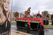 """Costaleros"" carrying an ornate float through the streets of Salamanca during Semana Santa (Holy Week) in the rain. Street processions are organized in most Spanish towns each evening, from Palm Sunday to Easter Sunday. People carry statues of saints on floats or wooden platforms, and an atmosphere of mourning can seem quite oppressive to onlookers."