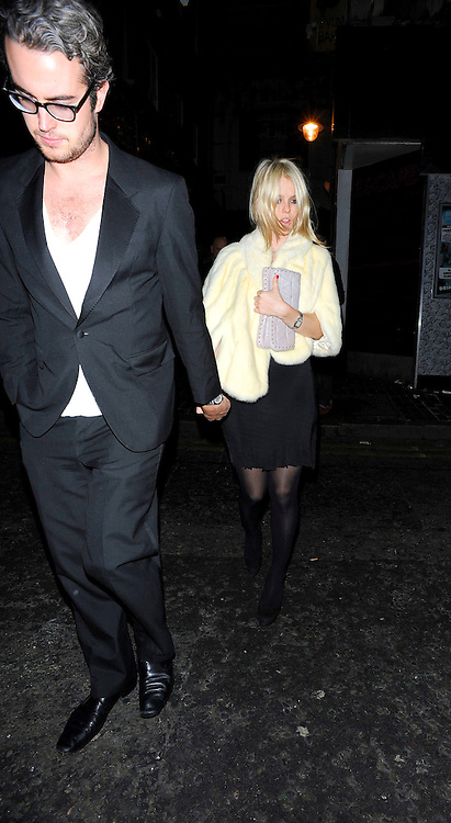 05.FEBRUARY.2011. LONDON<br /> <br /> ACTRESS ALICE EVE LEAVING THE BURLESQUE NIGHTCLUB THE BOX WITH HER BOYFRIEND ADAM O'RIORDAN IN SOHO CENTRAL LONDON.<br /> <br /> BYLINE: EDBIMAGEARCHIVE.COM<br /> <br /> *THIS IMAGE IS STRICTLY FOR UK NEWSPAPERS AND MAGAZINES ONLY*<br /> *FOR WORLD WIDE SALES AND WEB USE PLEASE CONTACT EDBIMAGEARCHIVE - 0208 954 5968*