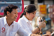 17 FEBRUARY 2013 - BANGKOK, THAILAND:  Pheu Thai gubernatorial candidate PONGSAPAT PONGCHAREON and Thai Prime Minister YINGLUCK SHINAWATRA campaign for Pongsapat in Bangkok Sunday. Pol General Pongsapat Pongcharoen, a former deputy national police chief who also served as secretary-general of the Narcotics Control Board is the Pheu Thai Party candidate in the upcoming Bangkok governor's election. (He resigned from the police force to run for Governor.) Former Prime Minister Thaksin Shinawatra reportedly recruited Pongsapat. Most of Thailand's reputable polls have reported that Pongsapat is leading in the race and likely to defeat Sukhumbhand Paribatra, the Thai Democrats' candidate and incumbent. The loss of Bangkok would be a serious blow to the Democrats, whose base is the Bangkok area.     PHOTO BY JACK KURTZ