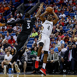 Mar 19, 2017; New Orleans, LA, USA; New Orleans Pelicans guard Jordan Crawford (4) shoots over Minnesota Timberwolves guard Kris Dunn (3) during the second half of a game at the Smoothie King Center. The Pelicans defeated the Timberwolves 123-109. Mandatory Credit: Derick E. Hingle-USA TODAY Sports