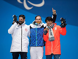 March 12, 2018 - Pyeongchang, South Korea - Left to right, silver medalist Keith Gabel of the US, Matti Suur-Hamari of Finland (gold) and Gurimu Narita of Japan (bronze) celebrate during a medal ceremony for Men's Snowboard Cross Monday, March 12, 2018 at the Medals Plaza for the 2018 Pyeongchang Winter Paralympic Games. Photo by Mark Reis (Credit Image: © Mark Reis via ZUMA Wire)