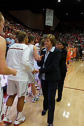 Dec 20, 2011; Stanford CA, USA;  Tennessee Lady Volunteers head coach Pat Summitt (right) shakes hands with the Stanford Cardinal during the second half at Maples Pavilion.  Stanford defeated Tennessee 97-80. Mandatory Credit: Jason O. Watson-US PRESSWIRE