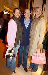 Left to right, HELENA BURTON, PAUL MCKENNA and CLARE STAPLES at a party to celebrate the 2nd anniversary of Quintessentially magazine held at Asprey, Bond Street, London on 24th February 2005.<br />
