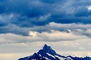 Schreckhorn and Lauteraarhorn and rain clouds of a cold front from the Niederhorn, Interlaken, Berne, Switzerland