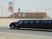 Exclusive<br /> First Super Bus Received in Dubai for Traveling from Dubai to Abu Dhabi  - Speed 250 Km/hr!!<br /> No use putting your hand out to stop this bus… it travels at 155 miles (250 km) an hour!<br /> The Superbus won't be dodging among the snail's-pace buses on traffic-clogged British streets, of course.<br /> Developed in Holland , it is more likely to carry its first passengers in the Middle East .<br /> There, the 75-mile (120km) commute between neighbouring Abu Dhabi and Dubai will be slashed to 30 minutes if the luxurious Superbus is put into service.<br /> The midnight-blue, electric-powered vehicle is the work of an astronaut and a former Formula One aerodynamics expert.<br /> Made of lightweight materials including aluminium, carbon fibre, fibreglass and polycarbonate, it is 49ft long (15 metres), 8ft wide (2.5 metres) and 5ft 5inches high (1.65 metres).<br /> Its 23 passengers, who enjoy standards of comfort equal to those experienced in a luxury limousine or private jet, enter and exit through eight gullwing-style doors on each side.<br /> The vehicle has been developed at the Delft University of Technology in Holland under the direction of Professor Wubbo Ockels, who in 1985 became the first Dutch citizen in space when he blasted off on board the space shuttle Challenger.<br /> The £7million project was backed by the Dutch government, the American chemicals company Dow and the Saudi conglomerate Sabic.<br /> The first commercial interest has come from the United Arab Emirates , to which the Superbus was flown in a jumbo transport aircraft.<br /> There, around Abu Dhabi airport, it was tested on ordinary roads for the first time, its batteries fired up by solar power.<br /> The plan is for the Superbus to travel on normal roads and normal speeds as it picks up passengers in either Abu Dhabi or Dubai .<br /> But when it leaves the city, it would switch to a dedicated concrete track running parallel to the existing motorway – accelerating to a crui