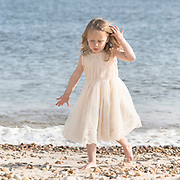 a 3 year old girl at the beach