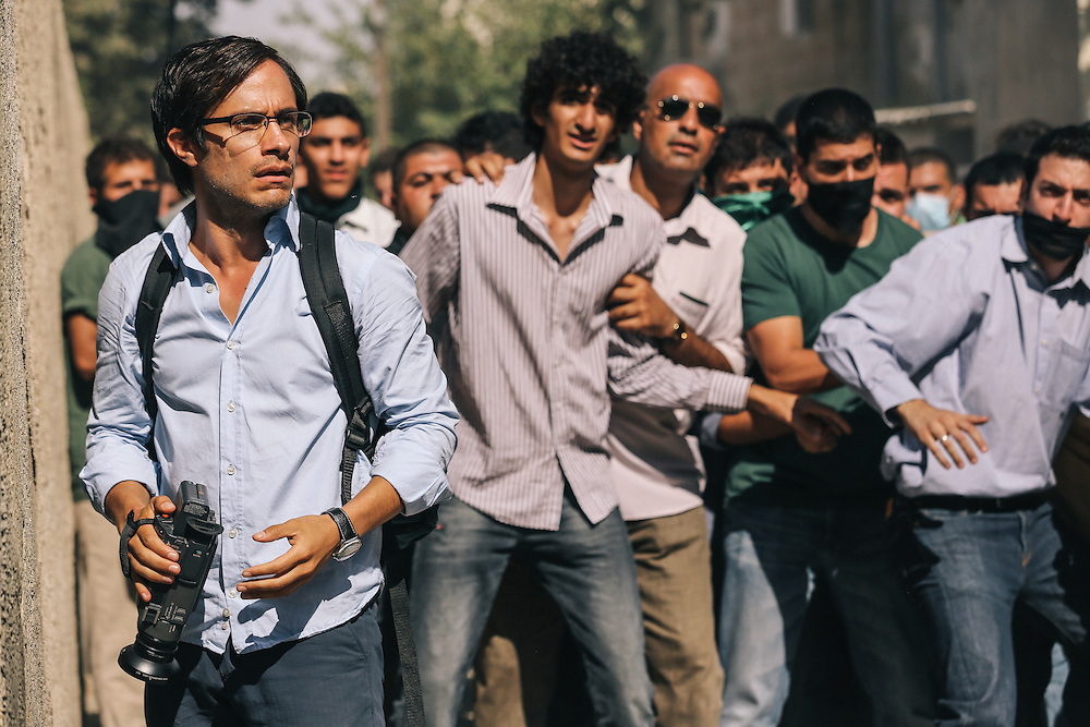"Actor Gael Garcia Bernal, in the role of Maziar Bahari on the set of Jon Stewart's feature film ""Rosewater."""