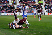 Kilmarnock FC Defender Kevin McHattie makes a vital tackle during the Ladbrokes Scottish Premiership match between Heart of Midlothian and Kilmarnock at Tynecastle Stadium, Gorgie, Scotland on 27 February 2016. Photo by Craig McAllister.