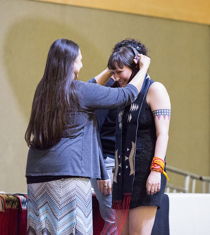 Native American graduates of Spokane receive honors and engage in activities in the Cataldo Globe Room on April 28. The event marked the 21st Annual Native American Community Graduation. Photo by Libby Kamrowski
