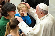 Pope Francis Blesses a baby and his Family during his weekly general audience at the Paul VI hall on January 10, 2018 at the Vatican.