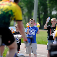 Briar Feldhaus, 8, (left to right), Ben Connor, 9 and E.J. Leetch offer riders Gatorade on Tuesday morning outside of Ephinany during the third day of the Tour de Kota. The kids were raising money for the Children's Care Corner Preschool and Daycare of Howard, S.D.