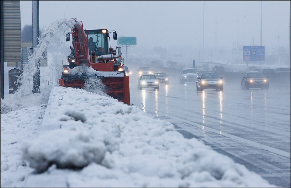 Clearing snow along the side of Interstate 35 in Kansas City, MO.