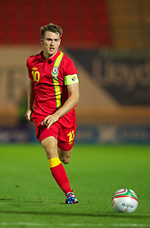 LLANELLI, WALES - Wednesday, August 15, 2012: Wales' captain Aaron Ramsey in action against Bosnia-Herzegovina during the international friendly match at Parc y Scarlets. (Pic by David Rawcliffe/Propaganda)