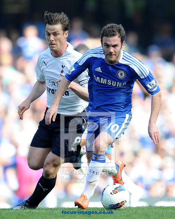 Picture by Andrew Timms/Focus Images Ltd. 07917 236526.24/03/12.Juan Mata of Chelsea and Scott Parker of Tottenham Hotspurs during the Barclays Premier League match at Stamford Bridge stadium, London.