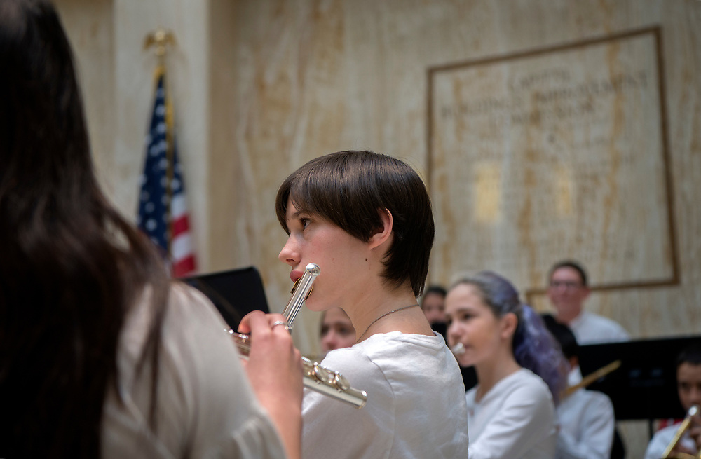 em020718d/a/Claudia Ferguson and othres with the Cimarron School 7th and 8th grade band perform in the Rotunda of the State Capitol in Santa Fe, Wednesday February 7, 2018.  (Eddie Moore/Albuquerque Journal)