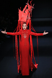 A model presents a creation by designer Hu Sheguang during the China Fashion Week in Beijing, capital of China, March 31, 2016. EXPA Pictures © 2016, PhotoCredit: EXPA/ Photoshot/ Li Mingfang<br /> <br /> *****ATTENTION - for AUT, SLO, CRO, SRB, BIH, MAZ, SUI only*****