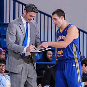 Santa Cruz Warriors Head Coach Casey Hill and Santa Cruz Warriors Guard Aaron Craft (14) seen reviewing a play in the second half of a NBA D-league regular season basketball game between the Delaware 87ers and the Santa Cruz Warriors (Golden State Warriors) Tuesday, Jan. 13, 2015 at The Bob Carpenter Sports Convocation Center in Newark, DEL