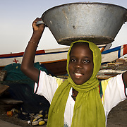 SAINT-LOUIS DU SENEGAL (Senegal). 2007. Girl in the fishermen´s harbour of Saint-Louis du Senegal