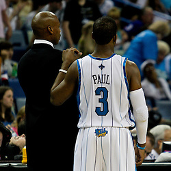 12 April 2009: New Orleans Hornets coach Byron Scott talks with guard Chris Paul (3) during a 102-92 victory by the New Orleans Hornets over the Dallas Mavericks on Easter Sunday at the New Orleans Arena in New Orleans, Louisiana.
