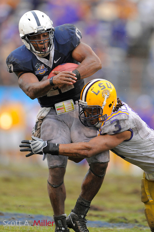 Jan. 1, 2010; Orlando, FL, USA; Penn State Nittany Lions quarterback Daryll Clark (17) is tackled by LSU Tigers safety Chad Jones (3) in Nittany Lions 19-17 win in the 2009 Capital One Bowl at the Citrus Bowl. Clark  was the game's MVP. ©2010 Scott A. Miller
