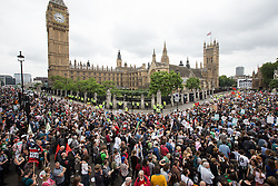 © Licensed to London News Pictures . 20/06/2015 . London , UK . Crowd in Parliament Square outside Parliament . Tens of thousands of people march from the Bank of England to Parliament , to protest economic austerity in Britain . Photo credit: Joel Goodman/LNP