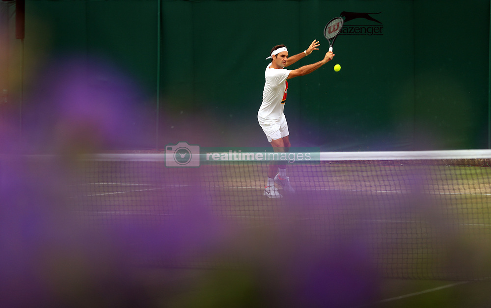 Roger Federer during a training session on day twelve of the Wimbledon Championships at The All England Lawn Tennis and Croquet Club, Wimbledon.