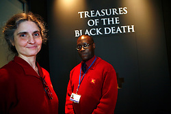 UK ENGLAND LONDON 3MAR09 - Security guards Rhonda Dagnolo and Anthony Codrington stand at the entrance to the 'Treasures of the Black Death' Exhibition at the Wallace Collection in London. This  exhibition brings to London for the first time two hoards of medieval gold and silver jewellery found at Colmar in the nineteenth century and at Erfurt in the 1990s. Both hoards were buried at the time of the Black Death in the middle of the fourteenth century, almost certainly by Jewish families who were expelled or murdered because the Jews were blamed for spreading the disease. ..jre/Photo by Jiri Rezac..© Jiri Rezac 2009