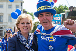 London, UK. 26 June, 2019. Anna Soubry, Change UK MP for Broxtowe, wishes noted anti-Brexit campaigner Steve Bray of SODEM (Stand of Defiance European Movement) a happy 50th birthday outside Parliament.