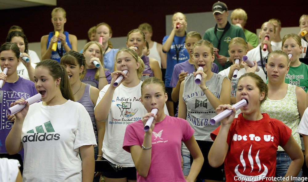 "MOC-Floyd Valley High School band members practice breathing down a tube at summer band camp in August.  ""Look around you,"" said band director Steve Connell on the first day of camp.  ""In this room ar the leaders of the school.  The most intelligent kids in the school... National Honor Society members... athletes.  I'm so blessed."""