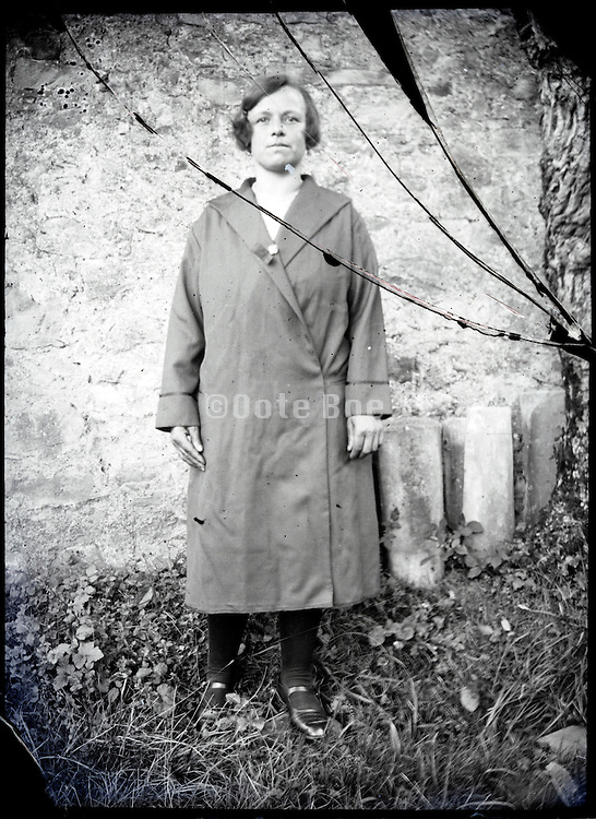 broken glass plate negative of a young adult woman posing outside 1920s