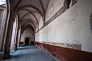 Arched hallway in the San Nicolas Tolentino Temple and Ex-Monastery in Actopan, Hidalgo, Mexico. The colonial church and convent  was built in 1546 and combine architectural elements from the romantic, gothic and renaissance periods.