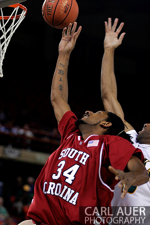 24 November 2005:Junior forward Renaldo Balkman (34) from the University of South Carolina grabs a first half rebound in the Gamecock's 65 - 60 victory over the University of Alaska Anchorage Seawolves in the first round of the Great Alaska Shootout at the Sullivan Arena in Anchorage Alaska.