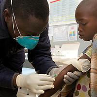 Lesotho, Kena clinic.<br /> Nurse Joseph Thabang Thaki takes a blood sample