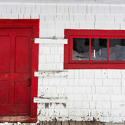 Red door on the LaRiviere sugarhouse in Big Six Township, Maine.