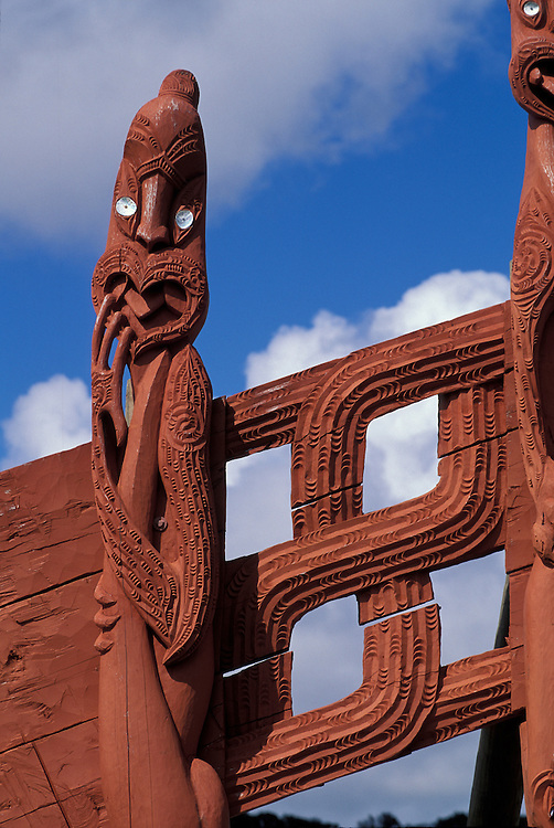 New Zealand, Maori carvings adorn a meeting house near the Waitangi National Reserve along the Bay of Islands.