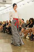 Gray checked skirt with front slit and white wrap top with three-quarter sleeves in a Japanese style. By Carmen Marc Valvo at the Spring 2013 Fashion Week show in New York.