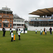 A game of cricket at Lord's in connection with the launch of the #ShowtheLove campaign. Schoolchildren from All Souls Primary School in London join MP James Heappey and Marylebone Cricket Club (MCC) Chief Executive Derek Brewer at Lord's to launch The Climate Coalition's #ShowtheLove campaign. The annual celebration of all that we love but could lose to climate change, from cricket pitches to woodlands, and the progress we are making towards a clean and secure future. The campaign encourages people to wear and share green hearts to demonstrate their support this Valentine's Day.