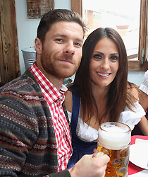 05.10.2014, Theresienwiese, München, GER, 1. FBL, FC Bayern Muenchen am Oktoberfest, im Bild Xabi Alonso (L) of FC Bayern Muenchen and his wife Nagore Aramburo attend the Oktoberfest 2014 beer festival at Kaefers Wiesenschaenke at Theresienwiese on 2014/10/05. EXPA Pictures © 2014, PhotoCredit: EXPA/ Eibner-Pressefoto/ Pool<br /> <br /> *****ATTENTION - OUT of GER*****