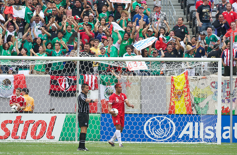 EAST RUTHERFORD, NEW JERSEY, USA - Sunday, May 27, 2012: Wales' Ashley Williams looks dejected as Mexico's Aldo De Nigris scores the opening goal during an International Friendly at the MetLife Stadium. (Pic by David Rawcliffe/Propaganda)