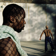 With space at a premium in the vast metropolis of Manhattan, New York City, locals find ways and means for pastime exercise and recreational activities as they go about their daily lives..Handball players in the West 4th Street courts during afternoon competition on May 3, 2004. Photo Tim Clayton..