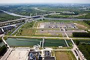 Nederland, Noord-Holland, Diemen, 25-05-2010. Eelektrische installatie (onderstation en verdeelstation) behorende bij de centrale Diemen van NUON. A1 met brug Amsterdm-Rijnkanaal. Onder in beeld de gasgestookte elektriciteitscentrale. Ook toekomstige lokatie voor de gasgestookte warmtekrachtcentrale Diemen 34. .Substation and gas-fired power plant. Future location for the gas-fired cogeneration Diemen 34. .luchtfoto (toeslag), aerial photo (additional fee required).foto/photo Siebe Swart