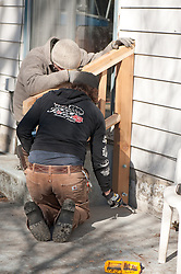 Volunteers from Rejuvenation work on Ms. Hinsey's home as part of REACH Community Builders' Spring Work Days.