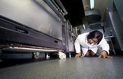 Environmental Health Officer inspecting kitchen London UK