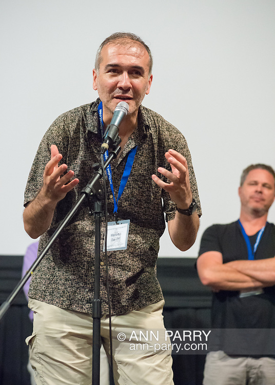 "Bellmore, New York, USA. 19th July 2017. Director and writer ARSHAK AMIRBEKYAN, at microphone, speaks during a Q&A at the Long Island International Film Expo LIIFE 2017. Screened earlier that evening was ""Mariam's Day Off"" a short foreign film filmed in Armenia, about a young prostitue invited to an artists studio to model. Behind him at right is Director BRAD KUHLMAN."