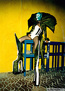 Trannie clubber in alien face paint, bodice, fishnet tights and massive platform boots, Ibiza 1999
