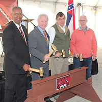 (Floyd Ingram / Buy at photos.chickasawjournal.com)<br /> Delta Furniture announced a 100-job expansion in Houlka in Chickasaw County Wednesday, Feb. 10. Shown pounding iron pins into a ceremonial I-beam at the factory announcement are Chickasaw County Board of Supervisors President Anderson McFarland, from left, MDA Executive Director Glenn McCullough, Delta CFO Jeff Hamilton and Delta President of Manufacturing Terry Wages.
