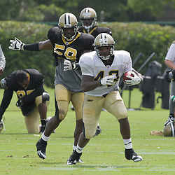 31 July 2009: New Orleans Saints running back P.J. Hill (43) avoids a tackle by linebacker Anthony Waters (59) during the opening day of New Orleans Saints training camp held at the team's practice facility in Metairie, Louisiana.