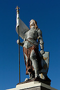 A statue of St. Joan of Arc, brought to Superior by Bishop Joseph M. Koudelka from Europe around 1920, stands in front of Holy Assumption Church. (Photo by Sam Lucero)