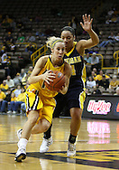 26 JANUARY 2009: Iowa guard Kristi Smith (11) drives inside while being defended by Michigan guard Jessica Minnfield (34) during the first half of an NCAA women's college basketball game Monday, Jan. 26, 2009, at Carver-Hawkeye Arena in Iowa City, Iowa. Iowa defeated Michigan 77-69.