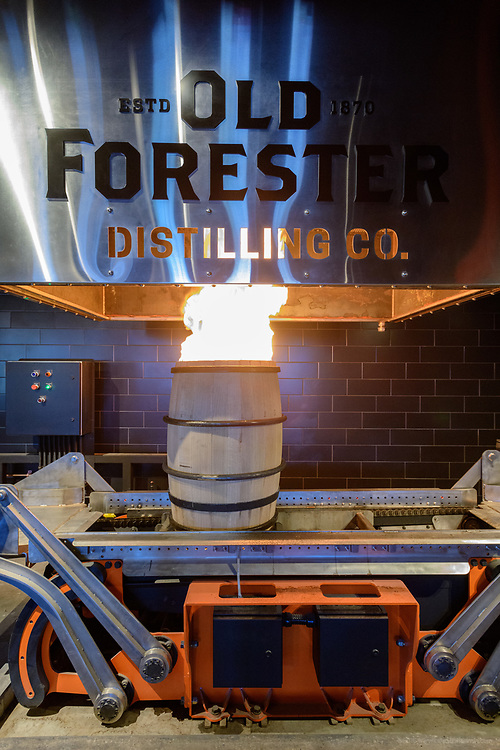 A barrel is charred in the cooperage area of the Old Forester Distilling Company on Whisky Row in Louisville, Ky. June 6, 2018